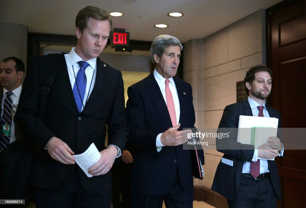 U.S. Secretary of State <a gi-track='captionPersonalityLinkClicked' href=/galleries/search?phrase=John+Kerry&family=editorial&specificpeople=154885 ng-click='$event.stopPropagation()'>John Kerry</a> (C) arrives for a closed briefing on Syria before Senate Foreign Relations Committee September 17, 2013 on Capitol Hill in Washington, DC. A team of UN inspectors found out a nerve gas attack against civilians did happen last month in Syria, according to the report they released to the UN Security Council on Monday.