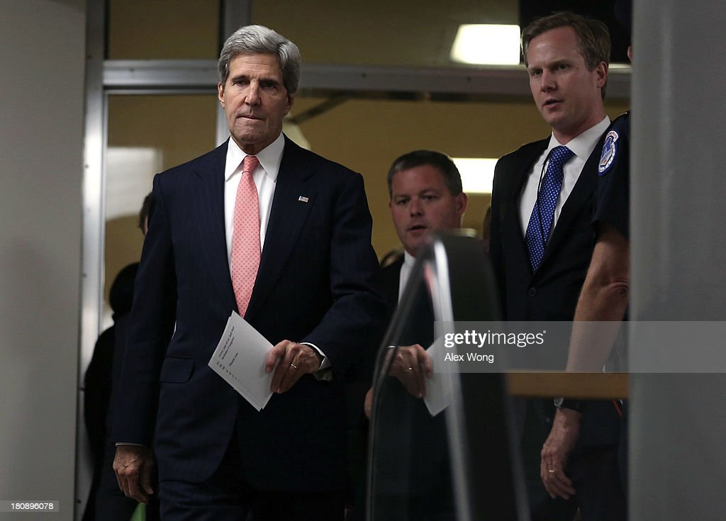 U.S. Secretary of State <a gi-track='captionPersonalityLinkClicked' href=/galleries/search?phrase=John+Kerry&family=editorial&specificpeople=154885 ng-click='$event.stopPropagation()'>John Kerry</a> (L) arrives for a closed briefing on Syria before Senate Foreign Relations Committee September 17, 2013 on Capitol Hill in Washington, DC. A team of UN inspectors found out a nerve gas attack against civilians did happen last month in Syria, according to the report they released to the UN Security Council on Monday.