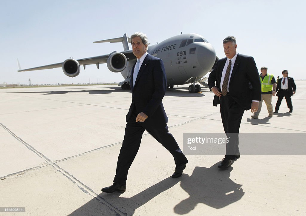 U.S. Secretary of State <a gi-track='captionPersonalityLinkClicked' href=/galleries/search?phrase=John+Kerry&family=editorial&specificpeople=154885 ng-click='$event.stopPropagation()'>John Kerry</a> arrives on an unannounced visit on March 24, 2013 to Baghdad, Iraq. Kerry is expected to urge Iraqi Prime Minister Nuri al-Maliki to ensure that Iranian flights over Iraq do not carry arms and fighters to Syria.