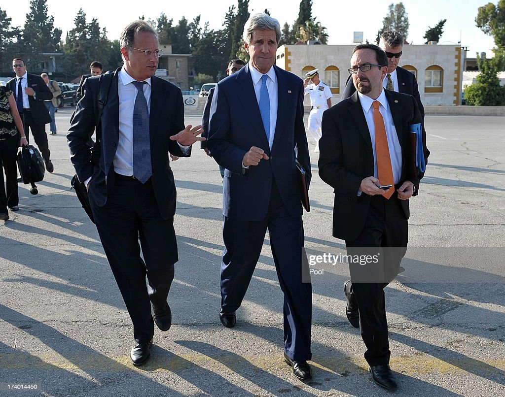 U.S. Secretary of State John Kerry (C) arrives to board a flight July 19, 2013 in Amman, Jordan. Kerry will hold new talks with Palestinian president Mahmud Abbas. Kerry met earlier with chief Palestinian negotiator Saeb Erakat in a final push to get a peace bid back on track before heading home.