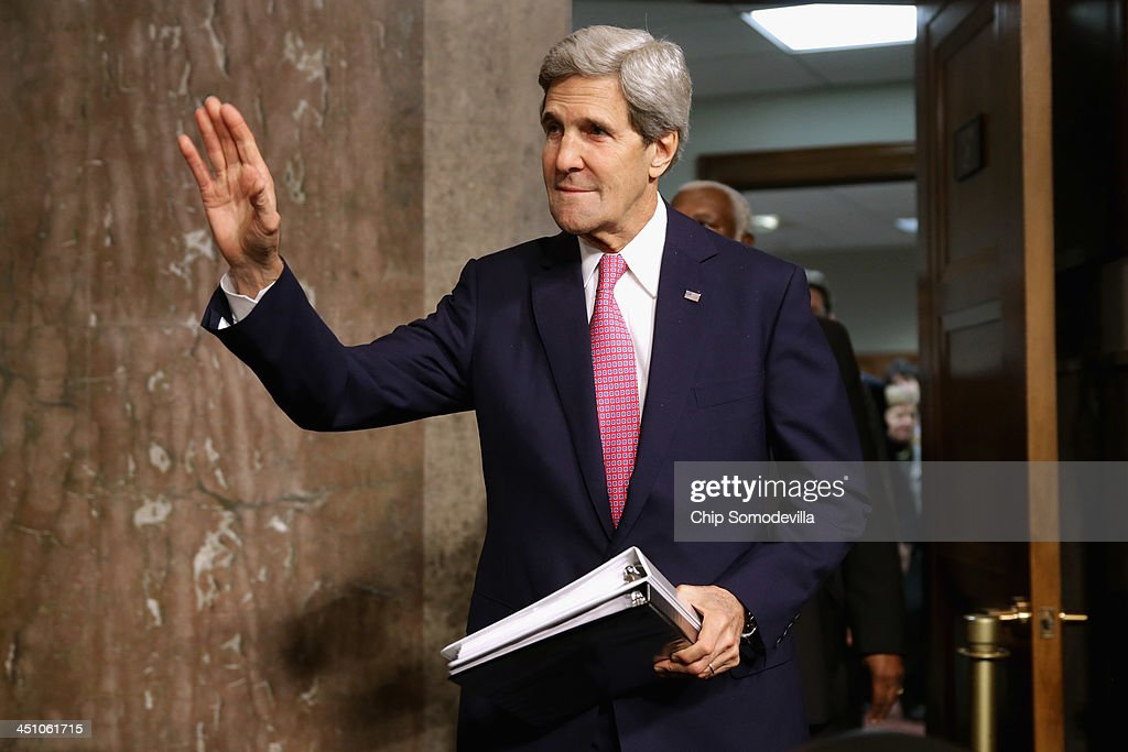 U.S. Secretary of State <a gi-track='captionPersonalityLinkClicked' href=/galleries/search?phrase=John+Kerry&family=editorial&specificpeople=154885 ng-click='$event.stopPropagation()'>John Kerry</a> arrives to testifies before the Senate Foreign Relations Committee about the Convention on the Rights of Persons with Disabilities in the Dirksen Senate Office Building on Capitol Hill November 21, 2013 in Washington, DC. Kerry encouraged the committee to vote for adoption of the treaty which he says will bring standards enjoyed by handicapped and disabled people in the United States to the international community.