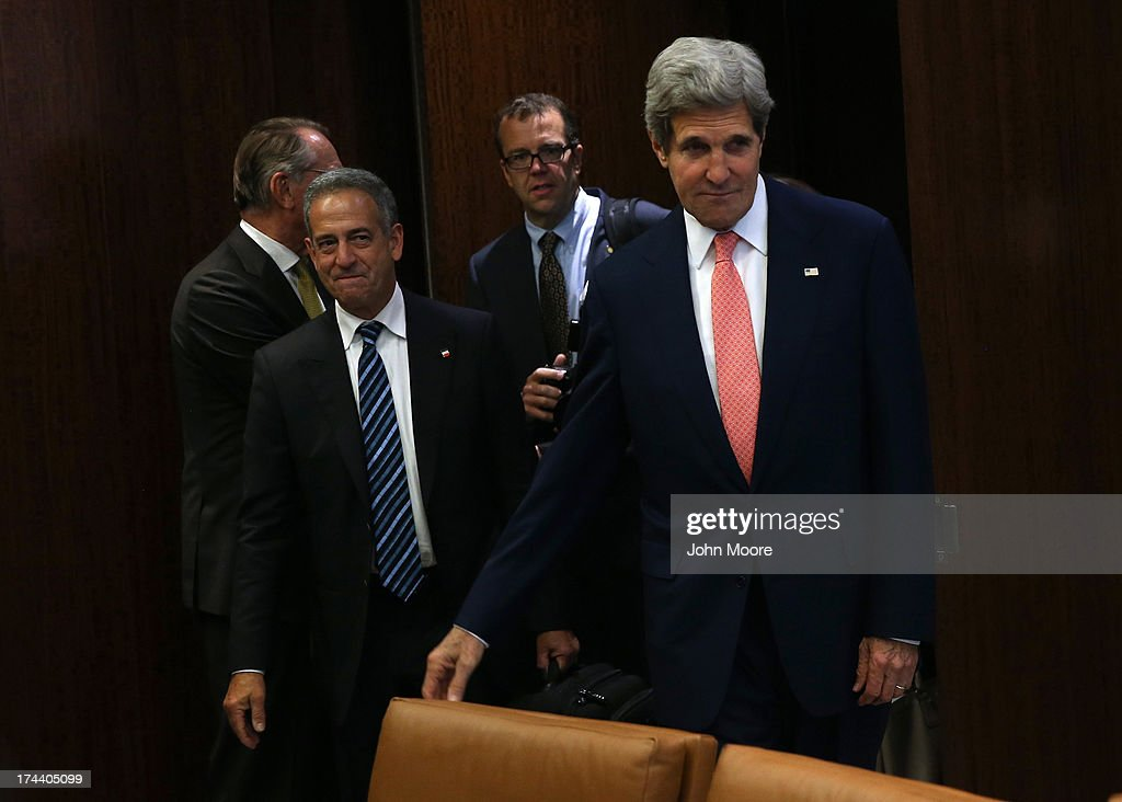 U.S. Secretary of State <a gi-track='captionPersonalityLinkClicked' href=/galleries/search?phrase=John+Kerry&family=editorial&specificpeople=154885 ng-click='$event.stopPropagation()'>John Kerry</a> (R), arrives with former U.S. Senator <a gi-track='captionPersonalityLinkClicked' href=/galleries/search?phrase=Russ+Feingold&family=editorial&specificpeople=539540 ng-click='$event.stopPropagation()'>Russ Feingold</a> before a meeting of the UN Security Council on July 25, 2013 in New York City. Kerry had named Feingold as the U.S. Special Representative for the African Great Lakes region to address violence in Congo. At the Security Council meeting Kerry expressed American support for the the UN Secretary General's Peace, Security and Cooperation Framework for the Democratic Republic of the Congo and the region.