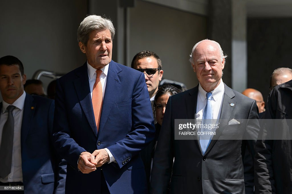 US Secretary of State John Kerry (L) arrives with UN Syria envoy Staffan de Mistura to a press briefing following a meeting on May 2, 2016 in Geneva. Syria's civil war is 'in many ways out of control' US Secretary of State John Kerry said Monday, as he tried to salvage a two-month ceasefire in the war-torn country. / AFP / FABRICE