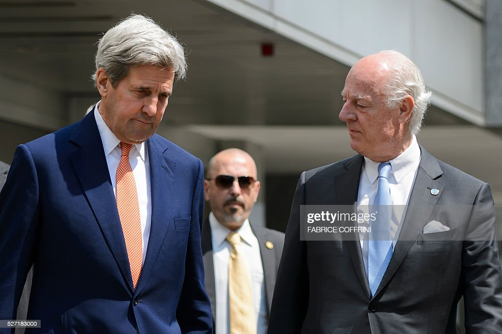 US Secretary of State John Kerry (L) arrives with UN Syria envoy Staffan de Mistura for a press briefing following a meeting on May 2, 2016 in Geneva. Syria's civil war is 'in many ways out of control' US Secretary of State John Kerry said on May 2, as he tried to salvage a two-month ceasefire in the war-torn country. / AFP / FABRICE
