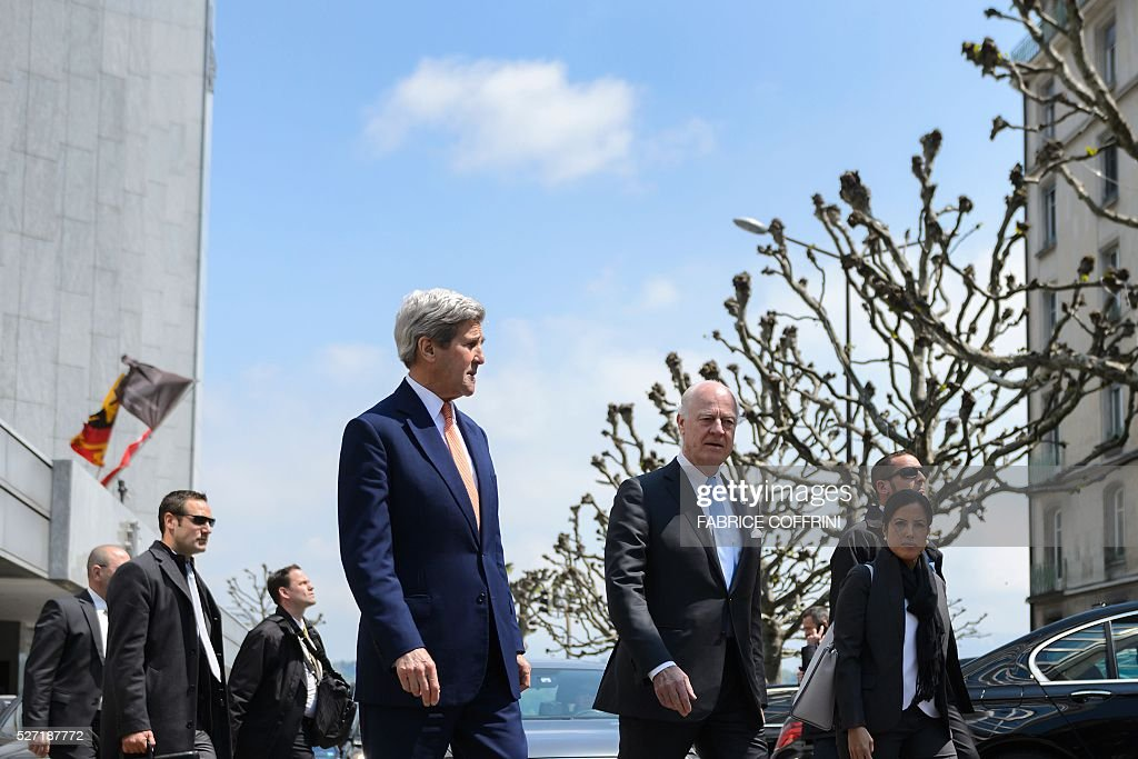 US Secretary of State John Kerry (C-L) arrives with UN Syria envoy Staffan de Mistura (C-R) to a press briefing following a meeting on May 2, 2016 in Geneva. Syria's civil war is 'in many ways out of control' US Secretary of State John Kerry said Monday, as he tried to salvage a two-month ceasefire in the war-torn country. / AFP / FABRICE
