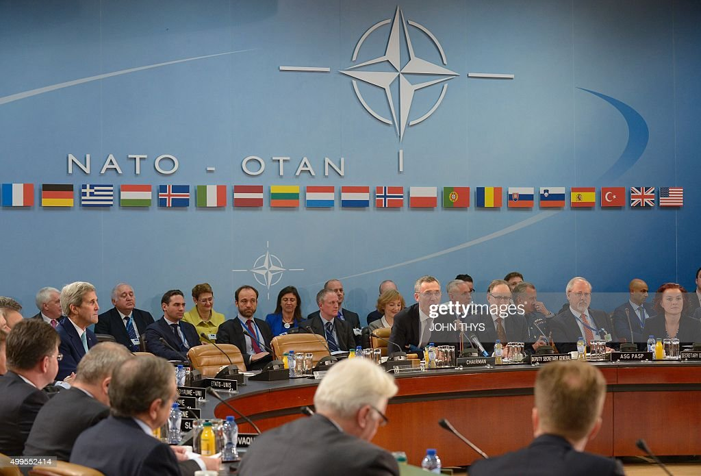 US Secretary of State John Kerry attends a Foreign Affairs ministers session with Montenegro on the second day of NATO ministerial meetings at the...