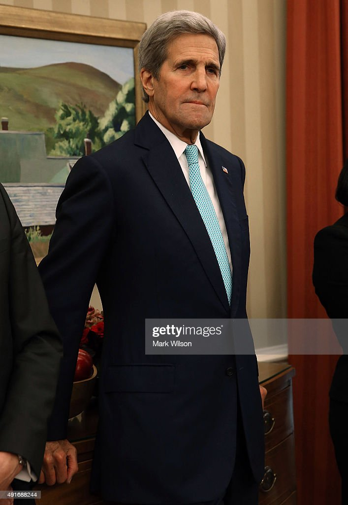US Secretary of State John Kerry attends a meeting with US President Barack Obama and German President Joachim Gauck in the Oval Office at the White House October 7, 2015 in Washington, DC. The two leaders participated in a bi lateral meeting that marked theÊ25th anniversary of German reunification