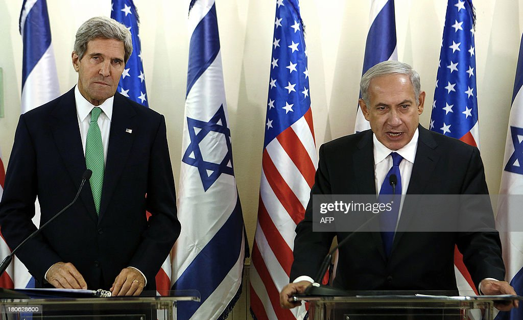 US Secretary of State John Kerry (L) attends a press conference with Israeli Prime Minister Benjamin Netanyahu at the prime minister office in Jerusalem on September 15, 2013. The threat of US military action against Syria remains 'real', Washington's top diplomat said a day after striking a deal with Russia to destroy Damascus's chemical weapons stockpile.
