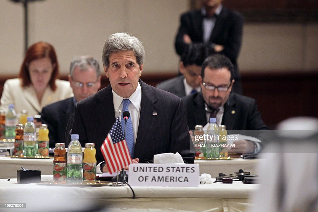 US Secretary of State John Kerry attends the 'Friends of Syria' meeting in Amman, Jordan on May 22, 2013. The gathering seeks to discuss US-Russian proposal to hold a peace conference dubbed 'Geneva 2' to bring together rebels and representatives of Syrian President's regime.