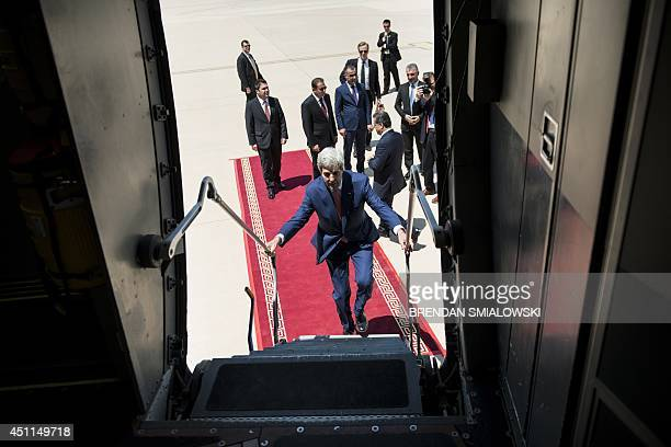 US Secretary of State John Kerry boards a cargo plane before departing Arbil International Airport June 24 2014 in Arbil Iraq Kerry is visiting...