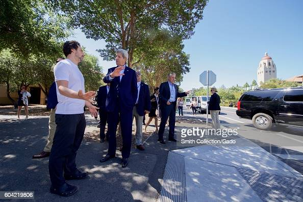 US Secretary of State John Kerry chats with Google CoFounder Sergey Brin after viewing one of Google's selfdriving cars at the 2016 Global...