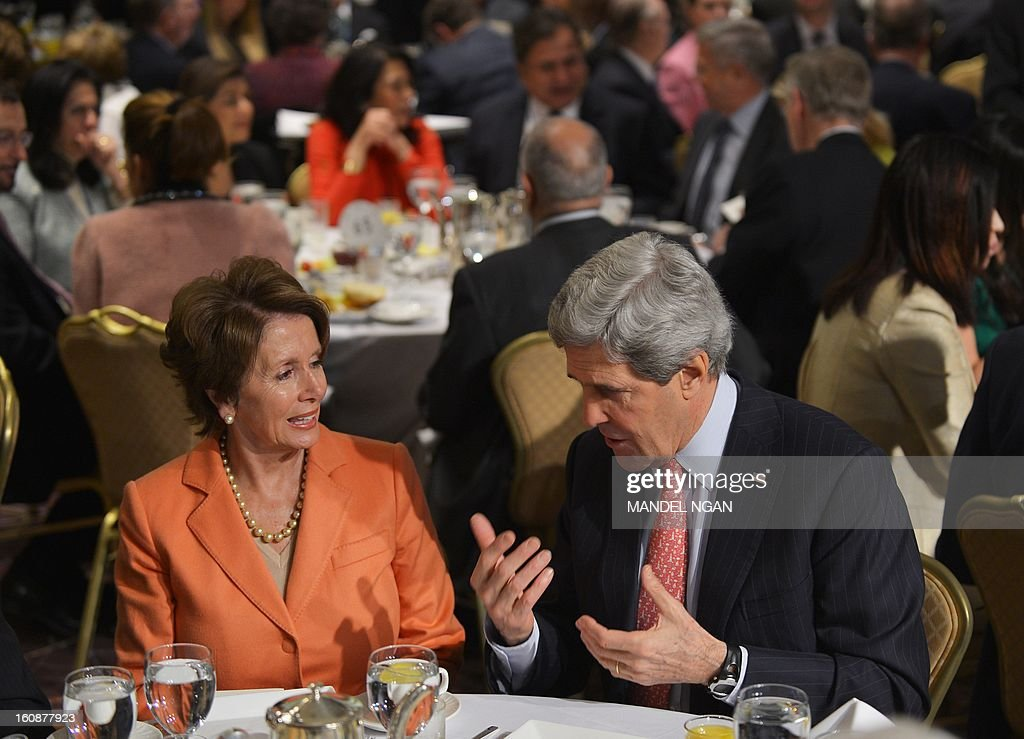 Secretary of State John Kerry (R) chats with House Minority Leader Nancy Pelosi, D-CA, during the National Prayer Breakfast on February 7, 2013 at a hotel in Washington, DC. AFP PHOTO/Mandel NGAN