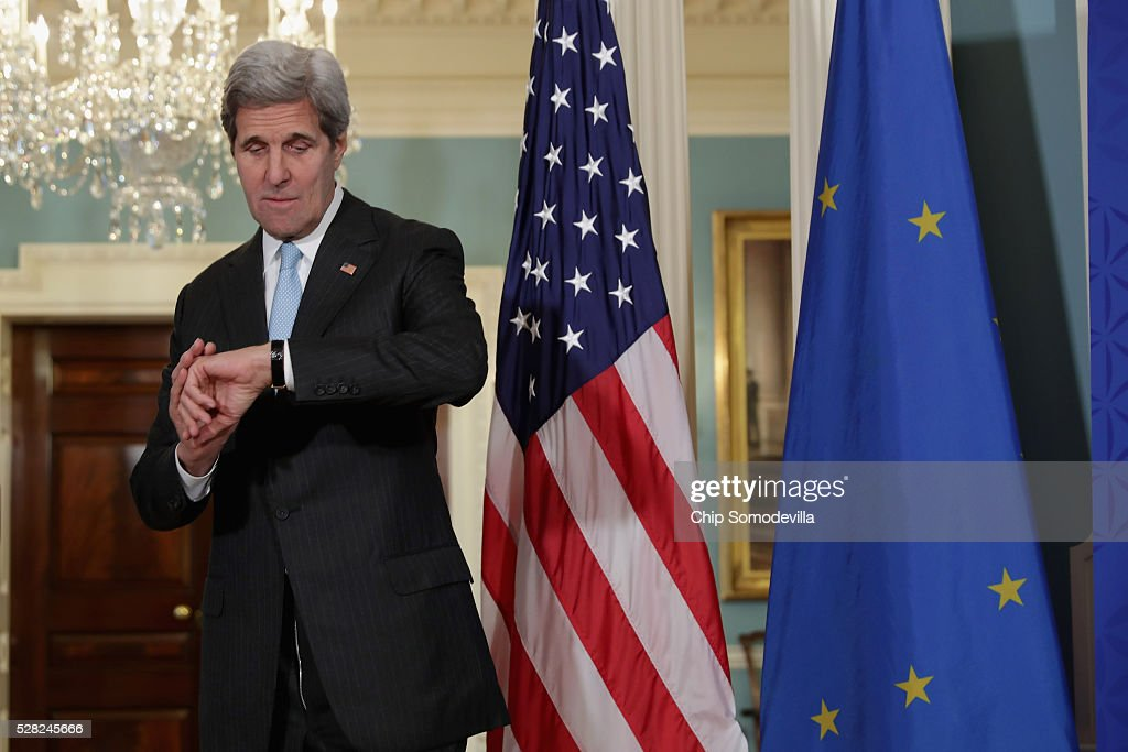 U.S. Secretary of State <a gi-track='captionPersonalityLinkClicked' href=/galleries/search?phrase=John+Kerry&family=editorial&specificpeople=154885 ng-click='$event.stopPropagation()'>John Kerry</a> checks his watch after refusing to answer reporters' questions in the Treaty Room at the State Department May 4, 2016 in Washington, DC. Kerry announced that the United States and Russia have agreed to extend the Syria truce to Aleppo and said that President Bashar al-Assad should start a political transition by August 1 to leave office and end the 5-year-old civil war.