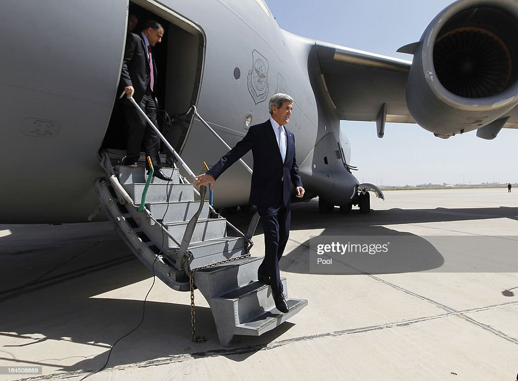 U.S. Secretary of State <a gi-track='captionPersonalityLinkClicked' href=/galleries/search?phrase=John+Kerry&family=editorial&specificpeople=154885 ng-click='$event.stopPropagation()'>John Kerry</a> climbs the steps from his plane as he arrives to meet with Iraq's Prime Minister Nouri al-Maliki (not pictured) on March 24, 2013 in Baghdad. According to a U.S. official, Kerry will urge Prime Minister Nuri al-Maliki to make sure Iranian flights over Iraq do not carry arms and fighters to Syria.