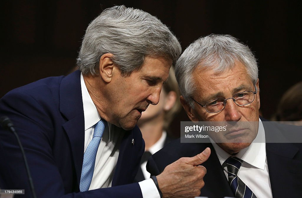 U.S. Secretary of State <a gi-track='captionPersonalityLinkClicked' href=/galleries/search?phrase=John+Kerry&family=editorial&specificpeople=154885 ng-click='$event.stopPropagation()'>John Kerry</a> (L) confers with U.S. Defense Secretary <a gi-track='captionPersonalityLinkClicked' href=/galleries/search?phrase=Chuck+Hagel&family=editorial&specificpeople=504963 ng-click='$event.stopPropagation()'>Chuck Hagel</a> as they testify before the Senate Foreign Relations Committee on the topic of 'The Authorization of Use of Force in Syria' September 3, 2013 in Washington, DC. U.S. President Barack Obama is attempting to enlist the support of members of the U.S. Congress for military action against the Syrian government for using chemical weapons against its own people last month.