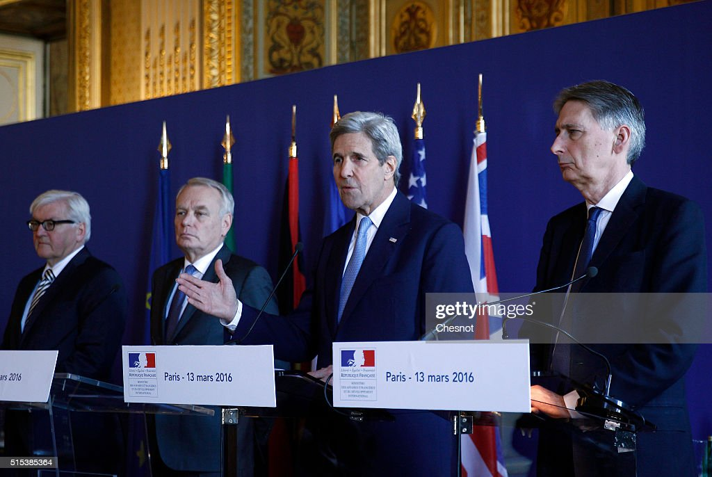 U.S. Secretary of State John Kerry delivers a speech next to German Foreign Minister Frank-Walter Steinmeier (L), French Foreign Minister Jean-Marc Ayrault (2L) and British Foreign Secretary Philip Hammond (R) during a press conference at the Quai d'Orsay ministry on March 13 , 2016 in Paris, France. Jean-Marc Ayrault met foreign affairs representatives to discuss matters relating to Libya, Syria and Yemen.
