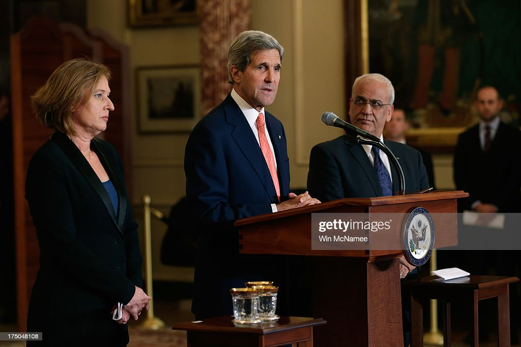 U.S. Secretary of State <a gi-track='captionPersonalityLinkClicked' href=/galleries/search?phrase=John+Kerry&family=editorial&specificpeople=154885 ng-click='$event.stopPropagation()'>John Kerry</a> (C) delivers remarks on the Middle East Peace Process Talks, as Israeli Justice Minister <a gi-track='captionPersonalityLinkClicked' href=/galleries/search?phrase=Tzipi+Livni&family=editorial&specificpeople=537394 ng-click='$event.stopPropagation()'>Tzipi Livni</a> and Palestinian chief negotiator <a gi-track='captionPersonalityLinkClicked' href=/galleries/search?phrase=Saeb+Erekat&family=editorial&specificpeople=233560 ng-click='$event.stopPropagation()'>Saeb Erekat</a> listen at the Department of State on July 30, 2013 in Washington, DC. Israeli Justice Minister <a gi-track='captionPersonalityLinkClicked' href=/galleries/search?phrase=Tzipi+Livni&family=editorial&specificpeople=537394 ng-click='$event.stopPropagation()'>Tzipi Livni</a> and Palestinian chief negotiator <a gi-track='captionPersonalityLinkClicked' href=/galleries/search?phrase=Saeb+Erekat&family=editorial&specificpeople=233560 ng-click='$event.stopPropagation()'>Saeb Erekat</a> joined Kerry in some of the first direct talks in three years between Israel and Palestine.