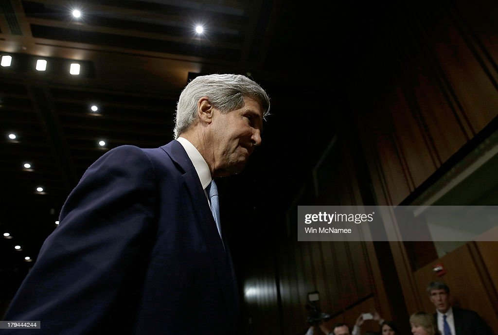 U.S. Secretary of State <a gi-track='captionPersonalityLinkClicked' href=/galleries/search?phrase=John+Kerry&family=editorial&specificpeople=154885 ng-click='$event.stopPropagation()'>John Kerry</a> departs after testifying before the Senate Foreign Relations Committee on the topic of 'The Authorization of Use of Force in Syria' September 3, 2013 in Washington, DC. U.S. President Barack Obama is attempting to enlist the support of members of the U.S. Congress for military action against the Syrian government for using chemical weapons against its own people last month.