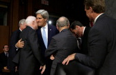 S Secretary of State John Kerry embraces Sen John McCain before Kerry testified before the Senate Foreign Relations Committee on the topic of 'The...