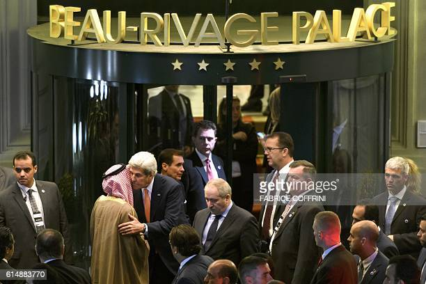 US Secretary of State John Kerry embrasses Saudi Arabia's Foreign Minister Adel alJubeir at the end of Syria peace talks on October 15 2016 in...