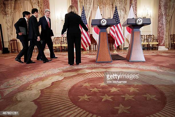 S Secretary of State John Kerry escorts Japanese Foreign Minister Fumio Kishida to a joint statement at the State Department February 7 2014 in...