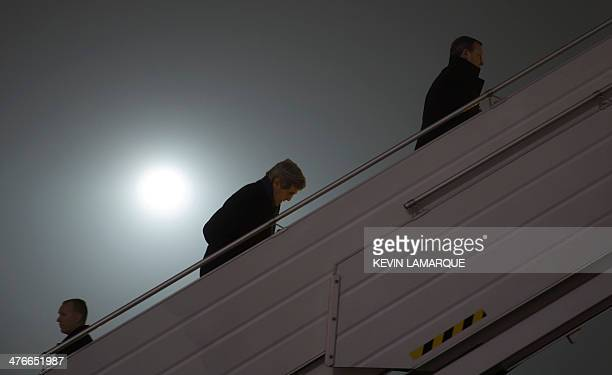 US Secretary of State John Kerry follows Ukraine Foreign Minister Andrii Deshchytsia on their way to board a plane to Paris on March 4 2014 in Kiev...