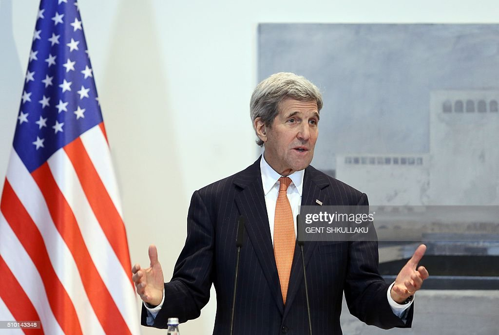 US Secretary of State John Kerry gestures as he speaks during a media statement in Tirana on February 14, 2016. US Secretary of State is in a few hours visit to Tirana, to meet with senior government leaders to discuss Albanias further Euro-Atlantic integration and strong bilateral cooperation with the United States. / AFP / GENT SHKULLAKU