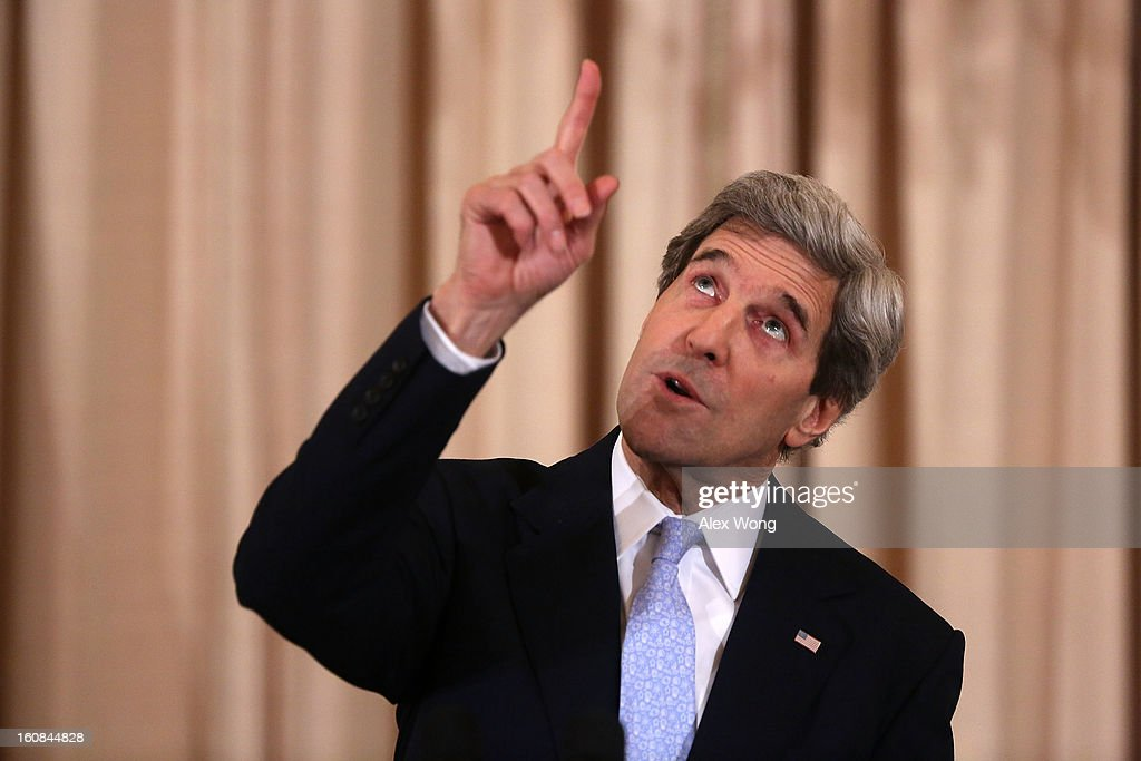 U.S. Secretary of State John Kerry gestures as he speaks during his ceremonial swearing in at the State Department February 6, 2013 in Washington, DC. Kerry was officially sworn in on February 1 at the U.S. Capitol as the 68th Secretary of State, succeeding Hillary Clinton.