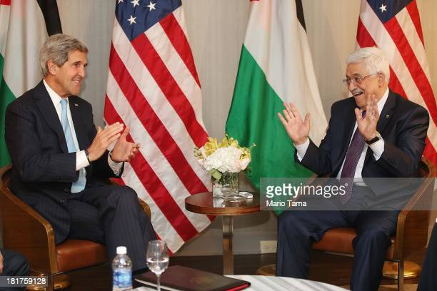 S Secretary of State John Kerry gestures at the start of a bilateral meeting with Palestinian Authority President Mahmoud Abbas on September 24 2013...