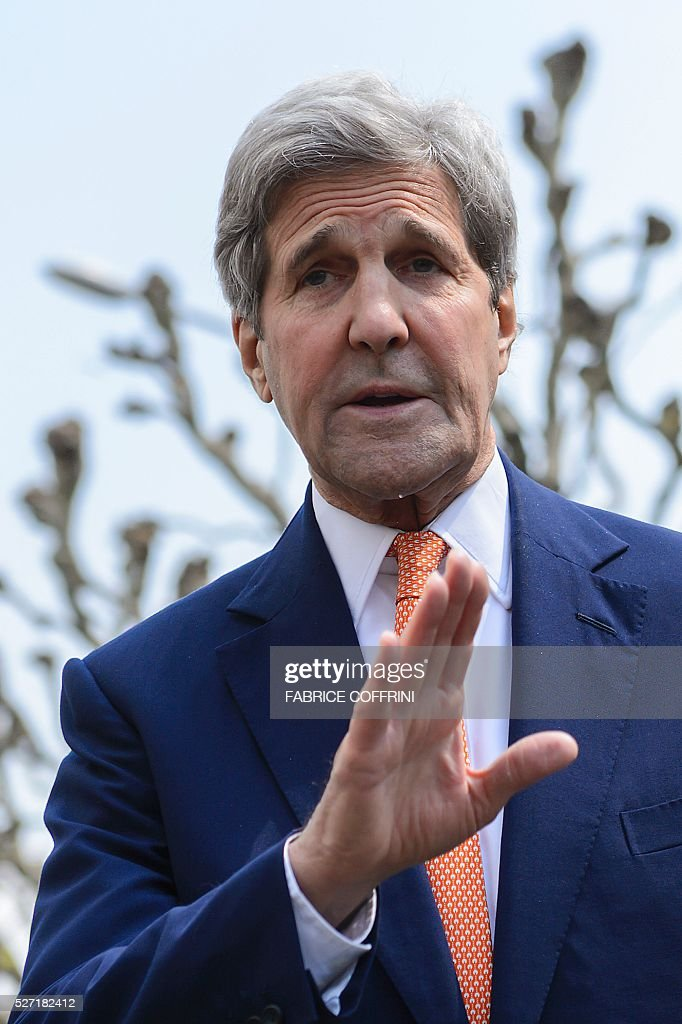 US Secretary of State John Kerry gestures during a press briefing following a meeting with UN Syria on May 2, 2016 in Geneva. Syria's civil war is 'in many ways out of control' US Secretary of State John Kerry said Monday, as he tried to salvage a two-month ceasefire in the war-torn country. / AFP / FABRICE