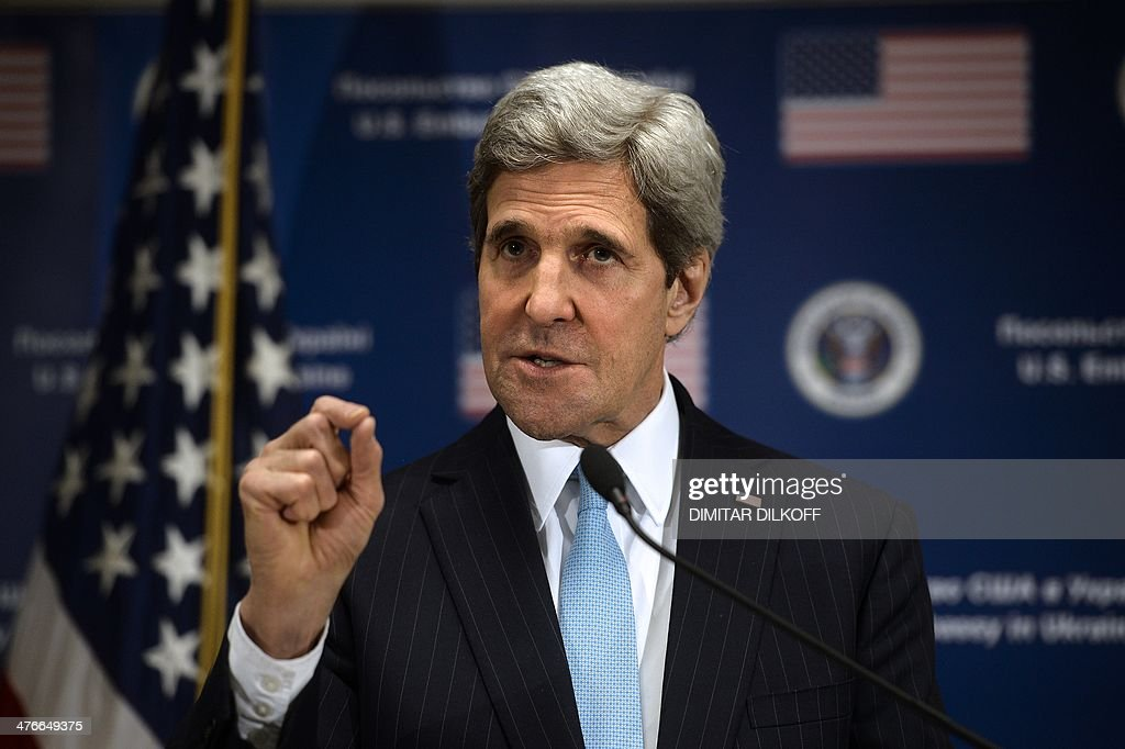 US Secretary of State John Kerry gestures during a press conference held at the US Embassy in Kiev on March 4, 2014. Kerry accused Russia on March 4 of looking for a 'pretext' to invade Ukraine after taking de-facto control of the ex-Soviet state's strategic Crimea peninsula. Russian forces have surrounded Ukrainian military bases across Crimea as the Russian-speaking autonomous region has been thrown into turmoil following the ouster last month of Moscow-backed president Viktor Yanukovych. Ukrainian officials said on March 3 that Russia had given Ukrainian soldiers in Crimea an ultimatum to surrender or face an all-out assault, although Russia denounced the claim as 'complete nonsense'.