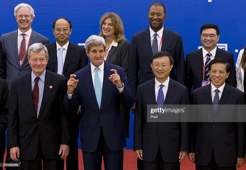 U.S. Secretary of State <a gi-track='captionPersonalityLinkClicked' href=/galleries/search?phrase=John+Kerry&family=editorial&specificpeople=154885 ng-click='$event.stopPropagation()'>John Kerry</a> (C) gestures next to Chinese State Council <a gi-track='captionPersonalityLinkClicked' href=/galleries/search?phrase=Yang+Jiechi&family=editorial&specificpeople=555098 ng-click='$event.stopPropagation()'>Yang Jiechi</a> as they pose fro a group photo with delegation from both countries of the China-U.S. EcoPartnerships signing ceremony at the Great Hall of the People on July 10, 2014 in Beijing, China.