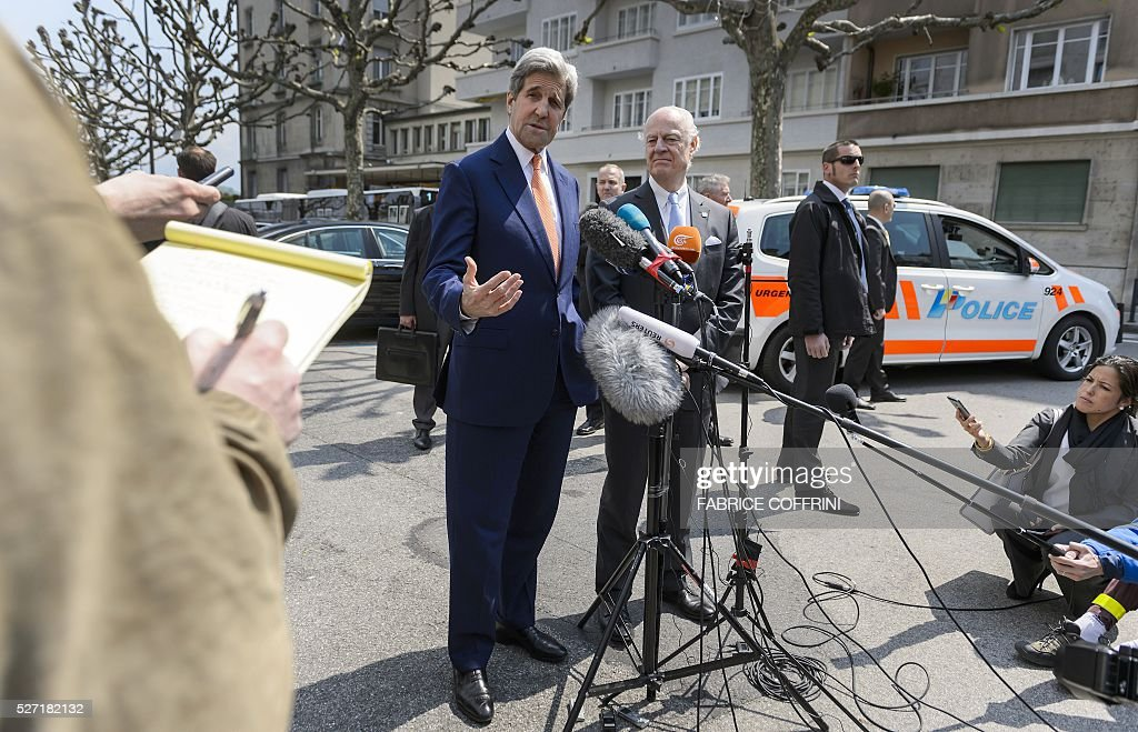 US Secretary of State John Kerry (L) gestures next to UN Syria envoy Staffan de Mistura during a press briefing following a meeting on May 2, 2016 in Geneva. Syria's civil war is 'in many ways out of control' US Secretary of State John Kerry said on May 2, as he tried to salvage a two-month ceasefire in the war-torn country. / AFP / FABRICE