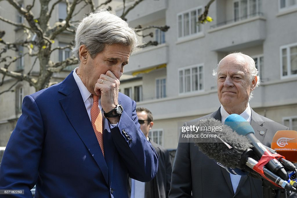 US Secretary of State John Kerry (L) gestures next to UN Syria envoy Staffan de Mistura during a press briefing following a meeting on May 2, 2016 in Geneva. Syria's civil war is 'in many ways out of control' US Secretary of State John Kerry said Monday, as he tried to salvage a two-month ceasefire in the war-torn country. / AFP / FABRICE