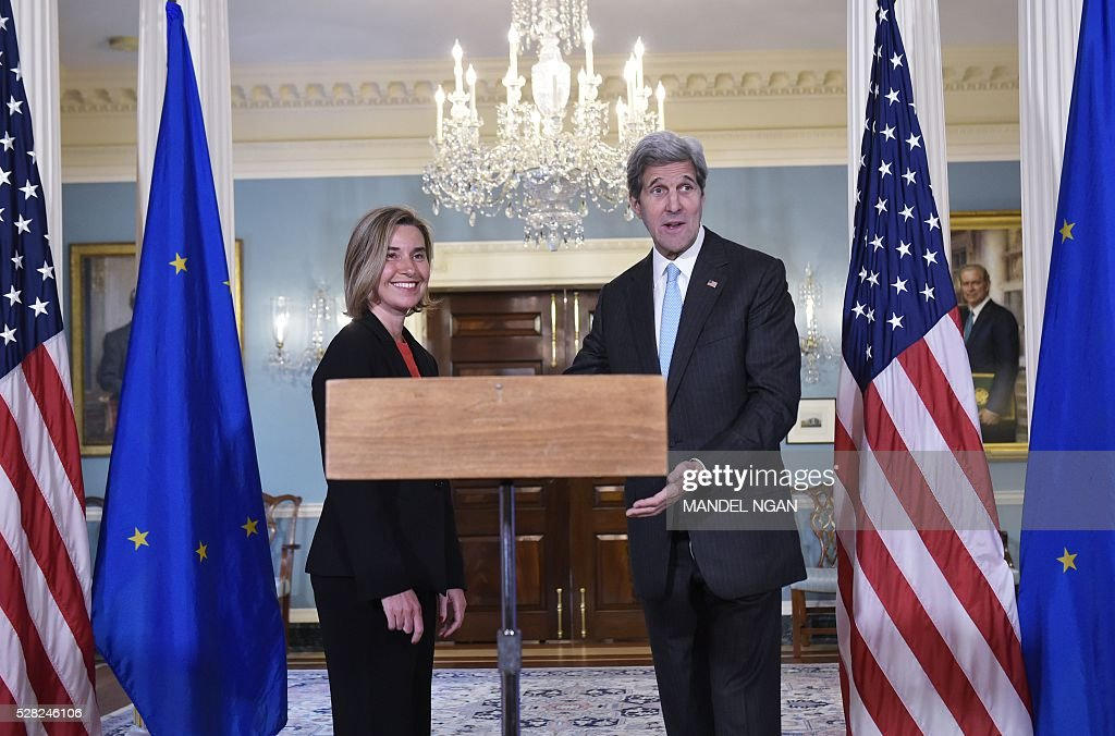 US Secretary of State John Kerry gestures to a reporter attempting to ask a question after delivering remarks to the press with European Union Foreign Affairs and Security Policy High Representative Federica Mogherini at the State Department on May 4, 2016. / AFP / MANDEL