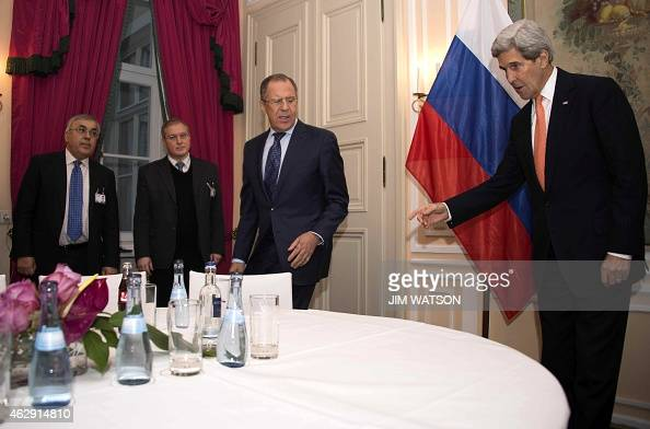 US Secretary of State John Kerry gestures while talking with Russian Foreign Minister Sergey Lavrov during a bilateral meeting at the 51st Munich...