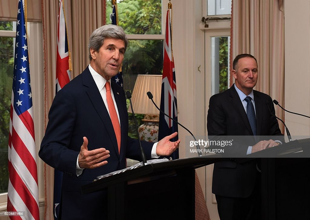 US Secretary of State John Kerry (L) gives a press conference with New Zealand Prime Minister John Key (R) at Premier House in Wellington, New Zealand on November 13, 2016. Kerry is travelling to New Zealand, Oman, the United Arab Emirates, Morocco and will attend the APEC summit in Peru later in the month. / AFP / AFP AND POOL / Mark RALSTON