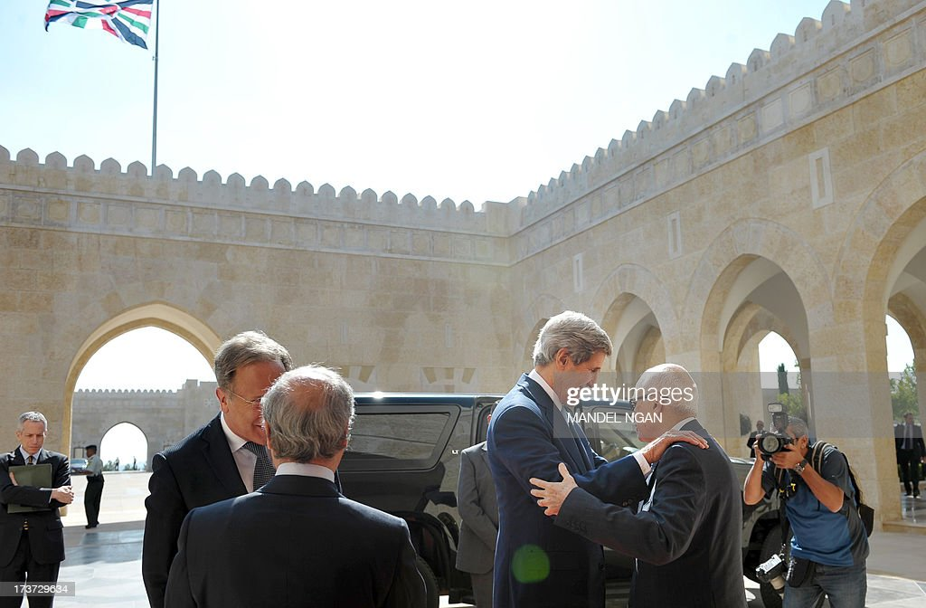 US Secretary of State John Kerry greets Arab League Secretary General Nabil al-Araby (R) as he arrives for a meeting with Jordan's King Abdullah II at the al-Hummar Palace on July 17, 2013 in Amman. Araby was departing the palace following a meeting with the King. Kerry is on his sixth visit to the region as he seeks to persuade the Israelis and Palestinians to resume direct negotiations which broke down almost three years ago. AFP PHOTO/Mandel NGAN