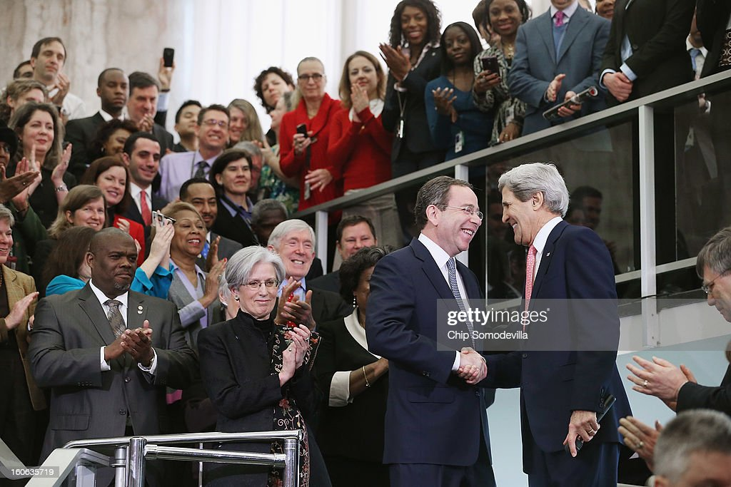 U.S. Secretary of State <a gi-track='captionPersonalityLinkClicked' href=/galleries/search?phrase=John+Kerry&family=editorial&specificpeople=154885 ng-click='$event.stopPropagation()'>John Kerry</a> (R) greets Deputy Secretary of State for Management and Resources Thomas Nides in the C Street Lobby during his first day at the State Department February 4, 2013 in Washington, DC. Kerry said he would work closely with President Barack Obama to make America safer and the world more prosperous and peaceful.