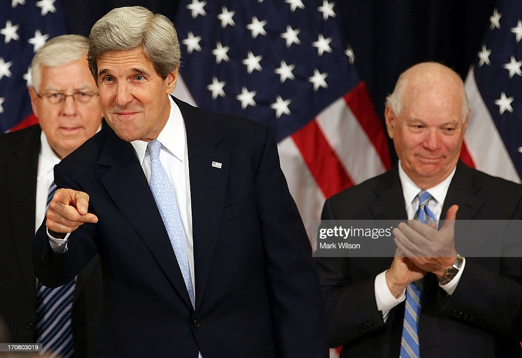 U.S. Secretary of State <a gi-track='captionPersonalityLinkClicked' href=/galleries/search?phrase=John+Kerry&family=editorial&specificpeople=154885 ng-click='$event.stopPropagation()'>John Kerry</a> (C), greets guests while flanked by Sen. <a gi-track='captionPersonalityLinkClicked' href=/galleries/search?phrase=Mike+Enzi&family=editorial&specificpeople=4099331 ng-click='$event.stopPropagation()'>Mike Enzi</a> (R-WY) (L), and Sen. <a gi-track='captionPersonalityLinkClicked' href=/galleries/search?phrase=Ben+Cardin&family=editorial&specificpeople=2302501 ng-click='$event.stopPropagation()'>Ben Cardin</a> (D-MD) (R) after speaking during the 10th Anniversary Celebration of the Presidents Emergency Plan for AIDS Relief (PEPFAR), at the State Department, June 17, 2013 in Washington, DC. The Presidents Emergency Plan for AIDS Relief is a U.S. Government initiative created to help save the lives of those suffering from HIV/AIDS around the world.Ê