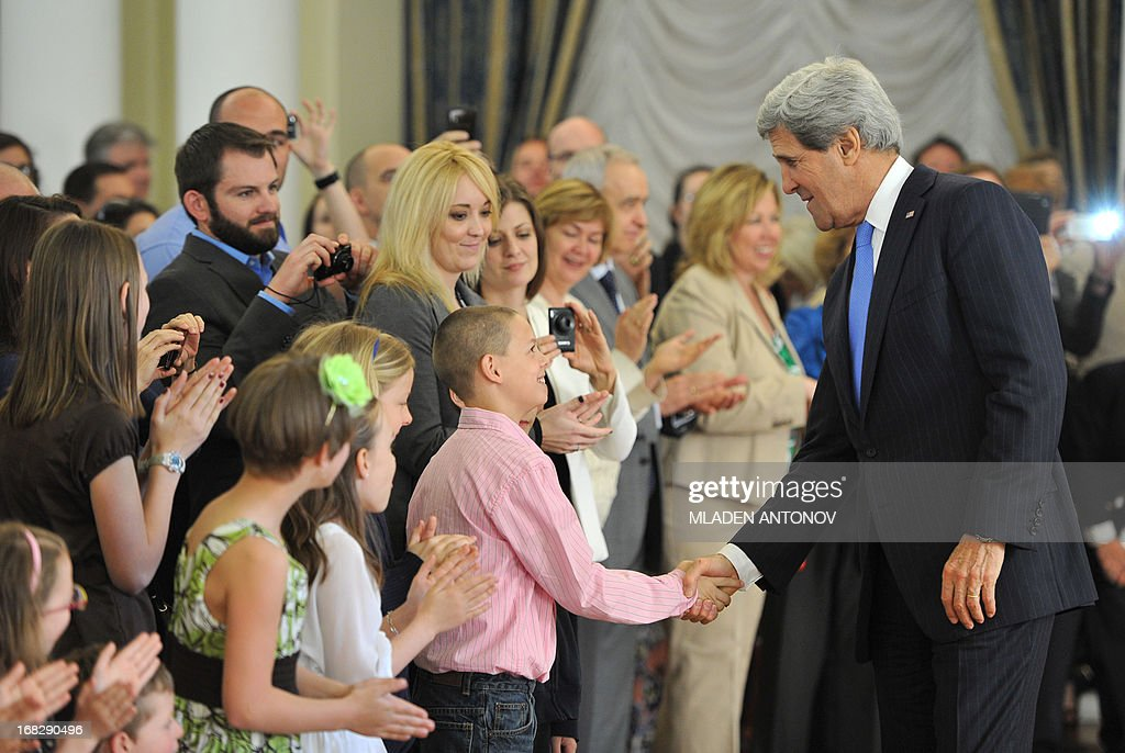 US Secretary of State John Kerry greets the children of the US embassy staff members during a 'meet and greet' event at Spaso House, the US Ambassador residence in Moscow, on May 8, 2013. Kerry arrived yesterday in Moscow for talks with Russian President Vladimir Putin, seeking to restore frayed US-Russia ties and win Moscow's support on the war in Syria.