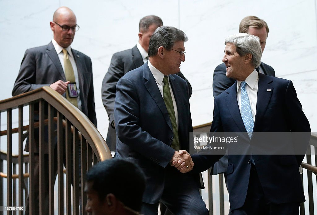U.S. Secretary of State <a gi-track='captionPersonalityLinkClicked' href=/galleries/search?phrase=John+Kerry&family=editorial&specificpeople=154885 ng-click='$event.stopPropagation()'>John Kerry</a> (R), greets U.S. Sen. <a gi-track='captionPersonalityLinkClicked' href=/galleries/search?phrase=Joe+Manchin&family=editorial&specificpeople=568465 ng-click='$event.stopPropagation()'>Joe Manchin</a> (D-WV) (C), as Kerry arrives at the U.S. Capitol for a briefing November 13, 2013 in Washington, DC. Kerry was scheduled to brief members of the Senate on Iran and the status of the P5+1 negotiations.