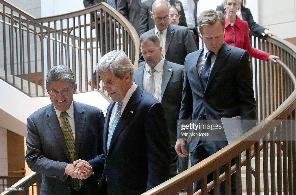 U.S. Secretary of State <a gi-track='captionPersonalityLinkClicked' href=/galleries/search?phrase=John+Kerry&family=editorial&specificpeople=154885 ng-click='$event.stopPropagation()'>John Kerry</a> (2nd L), greets U.S. Sen. <a gi-track='captionPersonalityLinkClicked' href=/galleries/search?phrase=Joe+Manchin&family=editorial&specificpeople=568465 ng-click='$event.stopPropagation()'>Joe Manchin</a> (D-WV) (L), as Kerry arrives at the U.S. Capitol for a briefing November 13, 2013 in Washington, DC. Kerry was scheduled to brief members of the Senate on Iran and the status of the P5+1 negotiations.
