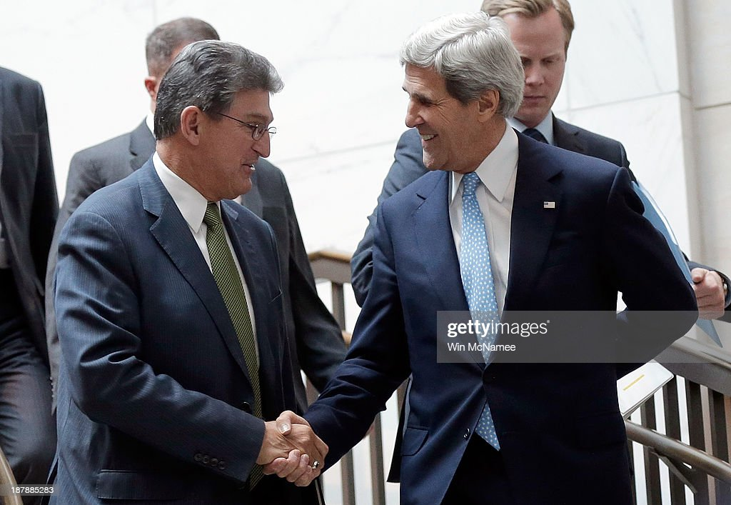 U.S. Secretary of State <a gi-track='captionPersonalityLinkClicked' href=/galleries/search?phrase=John+Kerry&family=editorial&specificpeople=154885 ng-click='$event.stopPropagation()'>John Kerry</a> (R), greets U.S. Sen. <a gi-track='captionPersonalityLinkClicked' href=/galleries/search?phrase=Joe+Manchin&family=editorial&specificpeople=568465 ng-click='$event.stopPropagation()'>Joe Manchin</a> (D-WV) (L), as Kerry arrives at the U.S. Capitol for a briefing November 13, 2013 in Washington, DC. Kerry was scheduled to brief members of the Senate on Iran and the status of the P5+1 negotiations.