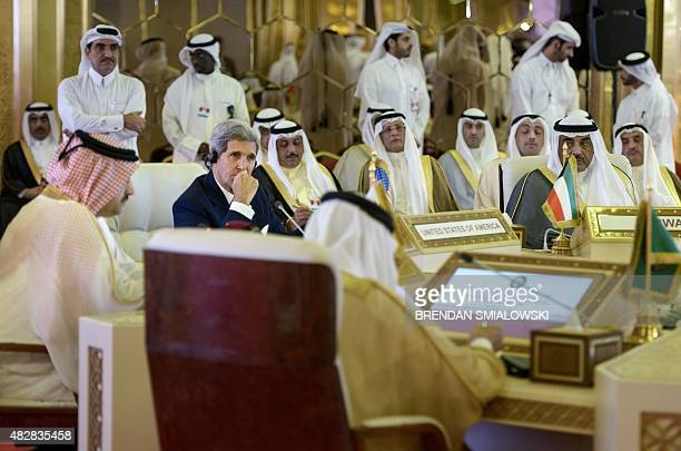US Secretary of State John Kerry Gulf Cooperation Council SecretaryGeneral Abdullatif bin Rashid Al Zayani of Bahrain and Kuwaits Foreign Minister...