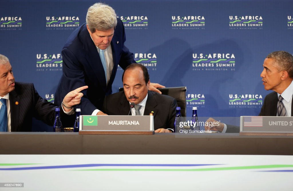 U.S. Secretary of State John Kerry (2nd L) helps Mauritania President Mohamed Ould Abdel Aziz (3rd L) on a microphone issue as U.S. President Barack Obama (R) and Prime Minister of Algeria Abdelmalek Sellal (L) look on during the first pleanery meeting of the U.S.-Africa Leaders Summit at the State Department August 6, 2014 in Washington, DC. Obama hosted last day of the first-ever summit to strengthen ties between the United States and African nations.