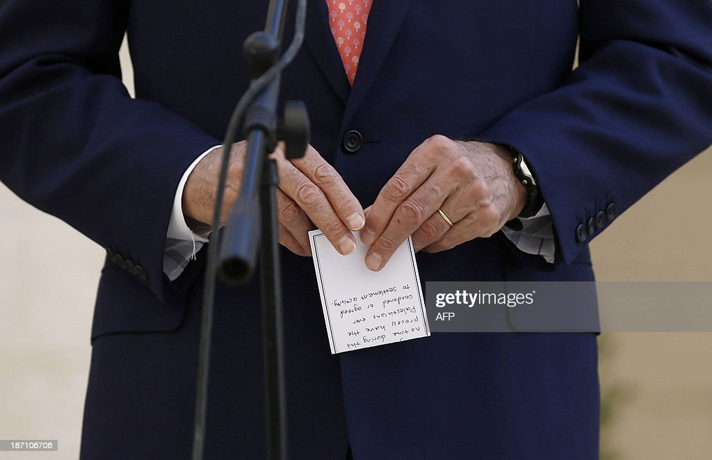 US Secretary of State John Kerry holds a handwritten note as he speaks to the press after his meeting with the Palestinian authority president on November 6, 2013 in Bethlehem. Kerry arrived in the region late on November 5 in a bid to keep fragile peace talks on track as recriminations grew following three months of negotiations that appear to have made little progress in resolving the decades-old conflict.
