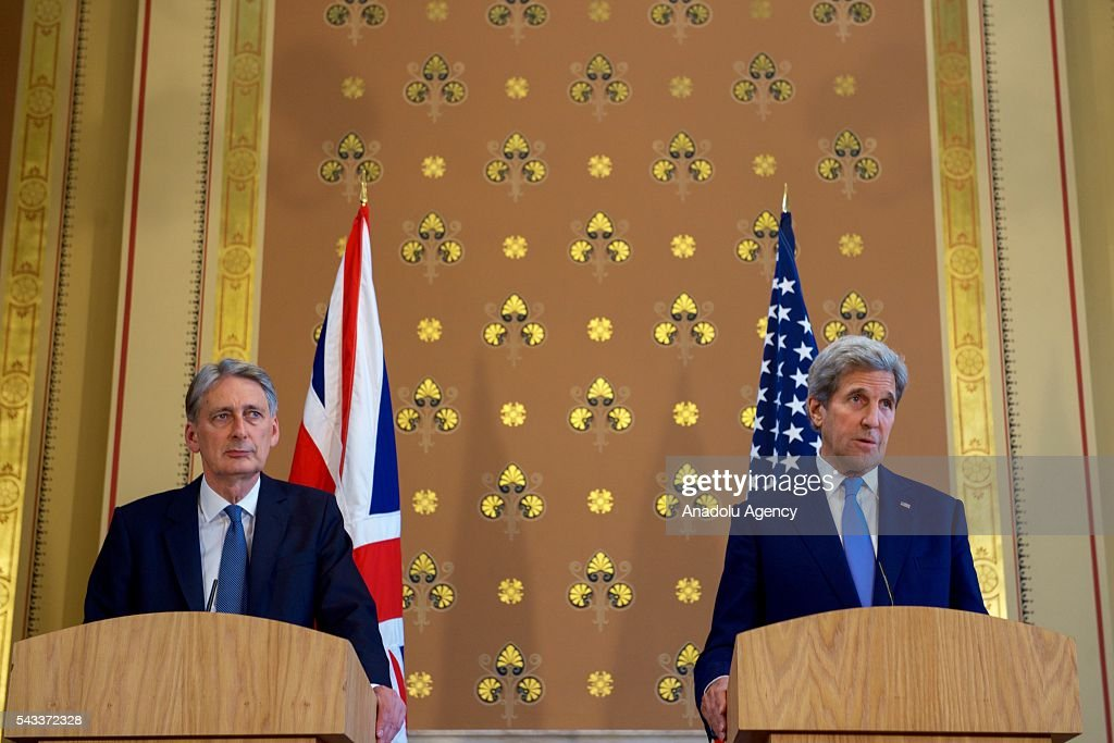 US Secretary of State John Kerry (R) holds a joint press conference with British Foreign Secretary Philip Hammond (L) after their meeting at the Foreign Ministry on June 27, 2016 in London, England.