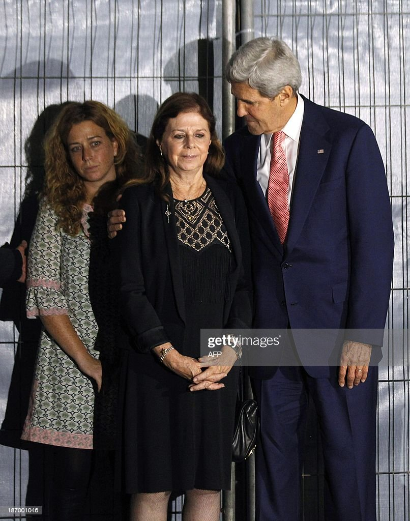 U.S. Secretary of State John Kerry hugs <a gi-track='captionPersonalityLinkClicked' href=/galleries/search?phrase=Dalia+Rabin-Pelossof&family=editorial&specificpeople=2575928 ng-click='$event.stopPropagation()'>Dalia Rabin-Pelossof</a>, daughter of assassinated Israeli Prime Minister Yitzhak Rabin, as Rabin's granddaughter Noa Rothman looks on, during a wreath laying ceremony at Rabin Square in Tel Aviv, on November 5, 2013. Rabin was assassinated nearby on November 4, 1995. AFP PHOTO/JASON REED/POOL