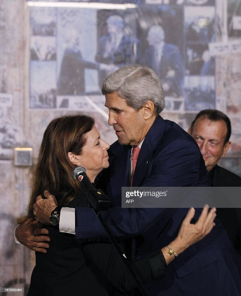 U.S. Secretary of State John Kerry hugs <a gi-track='captionPersonalityLinkClicked' href=/galleries/search?phrase=Dalia+Rabin-Pelossof&family=editorial&specificpeople=2575928 ng-click='$event.stopPropagation()'>Dalia Rabin-Pelossof</a>, the daughter of assassinated Israeli Prime Minister Yitzhak Rabin, following a wreath laying ceremony at Rabin Square in Tel Aviv, on November 5, 2013. Tel Aviv Mayor Ron Huldai is also pictured. Yitzhak Rabin was assassinated nearby on November 4, 1995. AFP PHOTO/JASON REED/POOL